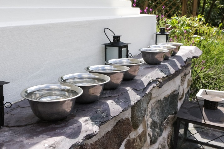 Buddhist water offering bowls meaning